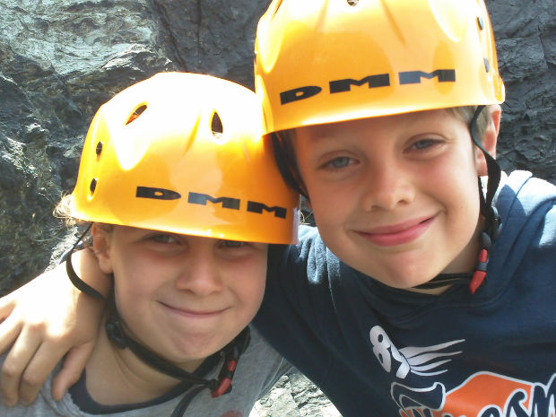 2 brothers climbing on the lizard