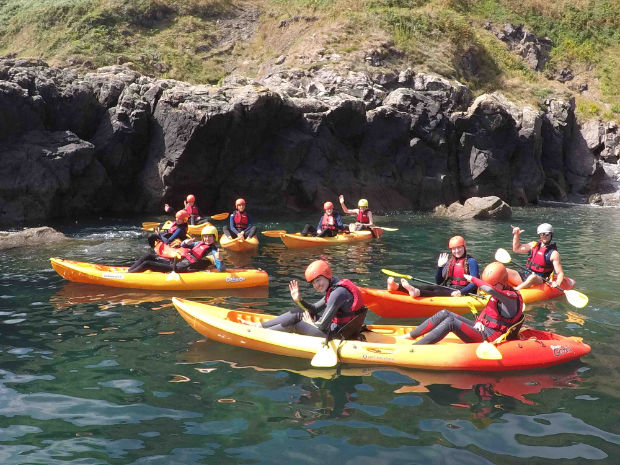 A family group kayaking on the lizard
